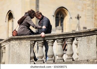young woman calming her boyfriend
