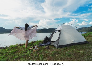 Young Woman Camping at Lake Relaxation Freedom Solitude Concept.