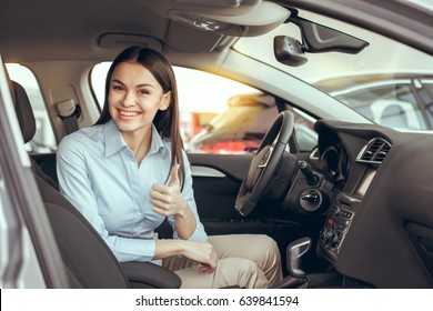 Young Woman in a Car Rental Service Test Drive Concept