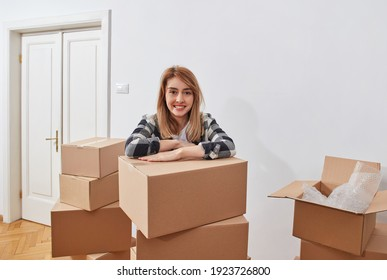 Young woman with cardboard boxes