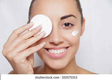 young woman cares for face skin relaxation, leisure, neck, innocence, bright, serene, sexuality, Woman using cotton pad