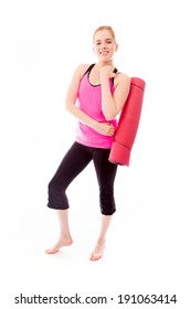 Young woman carrying exercise mat smiling