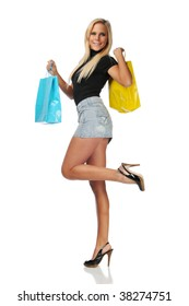 Young woman carrying shopping bags isolated on a white background
