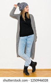 Young woman in casual autumn outfit. Full body length, no retouch, studio lighting.