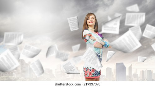 Young woman in casual and paper flying in air