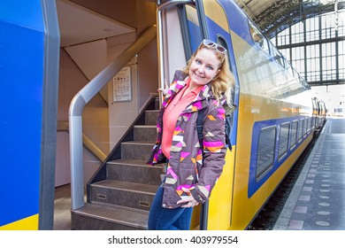 Young woman catching the train in Amsterdam central station in the Netherlands