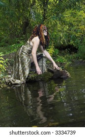 young woman in cat's mask sitting on the spring bank