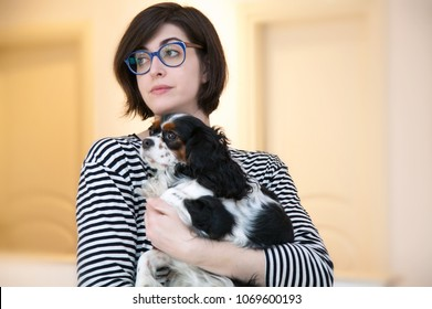 Young woman with Cavalier King Charles Spaniel dog