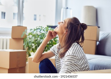 Young woman celebrates moving into a new apartment