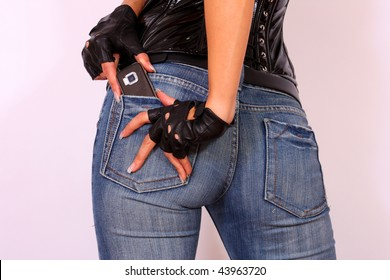 Young Woman With Cell Phone In Her Pocket