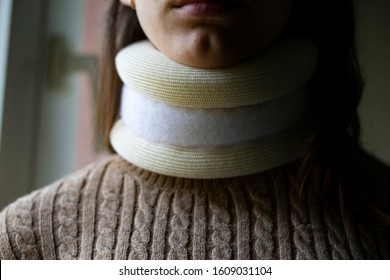 Young woman with a cervical collar. Neck brace and traffic accident Concept.