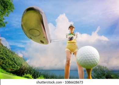 young woman in charge on tee off prepare herself ready to hit golf ball by holding tight wood driver in  both hand, with sunny and bright blue sky in background