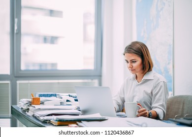 Young woman checking email at the office