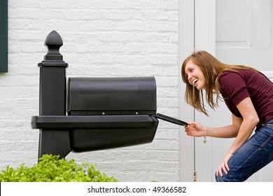 Young Woman Checking for Mail