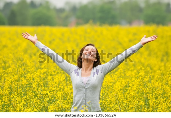 Young woman cheering in the field