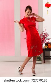 Young woman with cheongsam standing