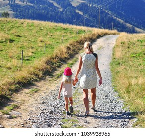 Young woman with a child on th country road