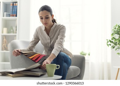 Young woman choosing the best upholstery for the armchair