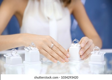 Young woman choosing ring in jewelry store