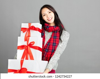 young woman with christmas gift box