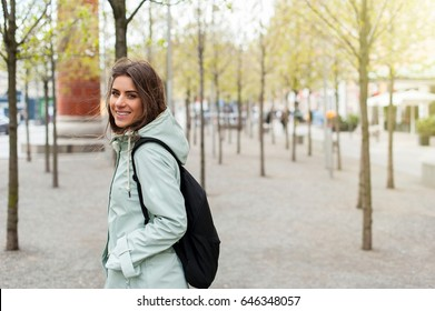 Young woman in the city with backpack