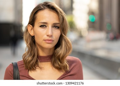 Young woman in city serious face portrait