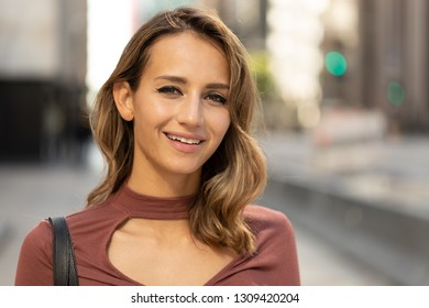Young woman in city smile happy face portrait