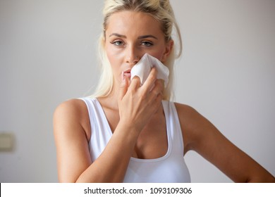 Young woman clean face and eyes with wet wipes, remove make-up, body breast lingerie