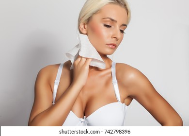 Young woman clean neck with wet wipes, body lingerie