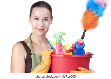 A young woman with cleaning equipment ready to clean - on white.