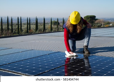 young woman cleaning photovoltaic panels