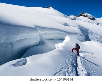 Young woman climber hiker on the glacier in the Alps