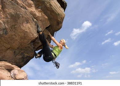 Young woman climbing an extreme rock - Charlotte Frank at the Windstein - Vosges - France