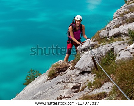 Klettersteig Clipart : Young woman climbs via ferrata klettersteig stockfoto jetzt