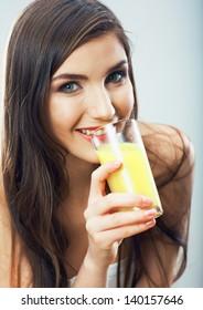 Young woman close up portrait drink juice. Female model happy smile.