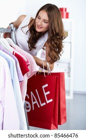 Young woman at clothing store at sales period