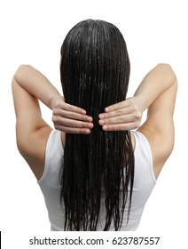 Young woman with coconut oil applied onto hair, on white background