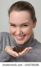 young woman with coffee beans in her hand