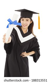 young woman college graduate wearing cap and gown holding diploma