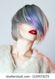 young Woman with colorful Hair, dressed in White Fur. fashion Beauty Model Girl with trendy color hair and red Lips