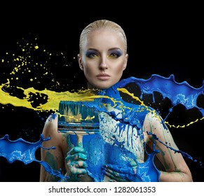 Young woman with colorful paint splashes