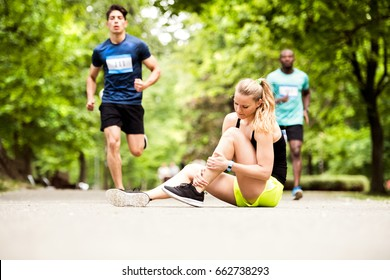 Young woman at the competition with sprained ankle.