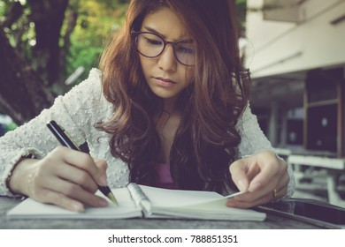 young woman concentrate reading book. girl learning writing homework. education assessment concept. Student studying college exam, doing homework at university. concentration on admissions in college.