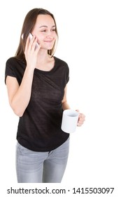 Young woman connected using smart mobile phone taking hot drink in mug in white background