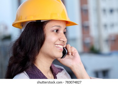 Young woman  construction architect talking on cellphone