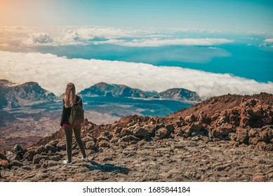 Young woman contemplating the entire Tenerife island from the top of the Teide Volcano