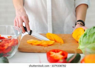 Young Woman Cooking. Healthy Food - Vegetable Salad. Diet. Healthy Lifestyle. Cooking At Home. Prepare Food