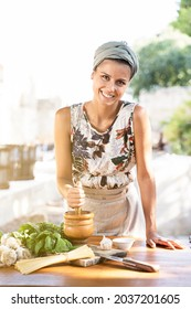 Young Woman Cooking Healthy mediterranean Food outdoor. lifestyle concept