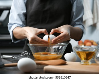 Young woman cooking in kitchen, closeup