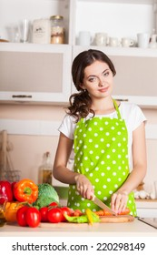 Young Woman Cooking in the kitchen. Healthy Food. Dieting Concept. Healthy Lifestyle. Cooking At Home. Prepare Food
